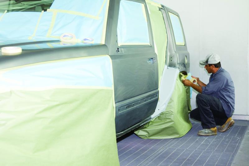 Painter taping vehicle
